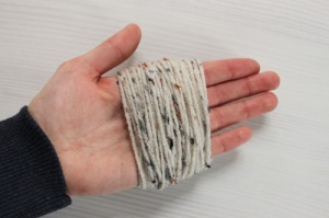 Wrapping yarn on hand